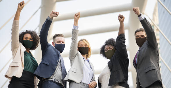 Successful business people in mask during covid 19 pandemin